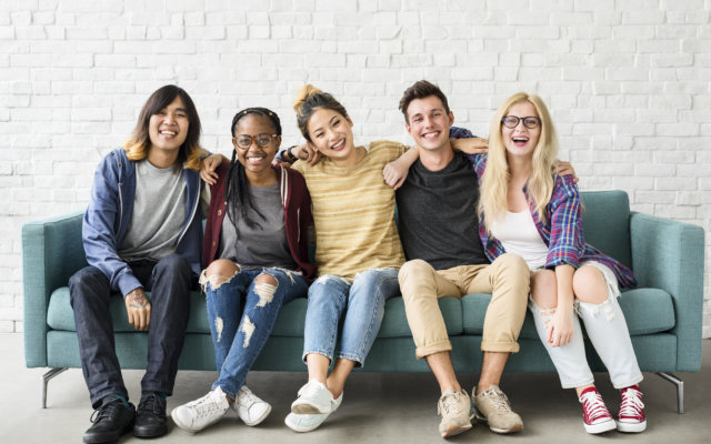 group of people smiling at the camera