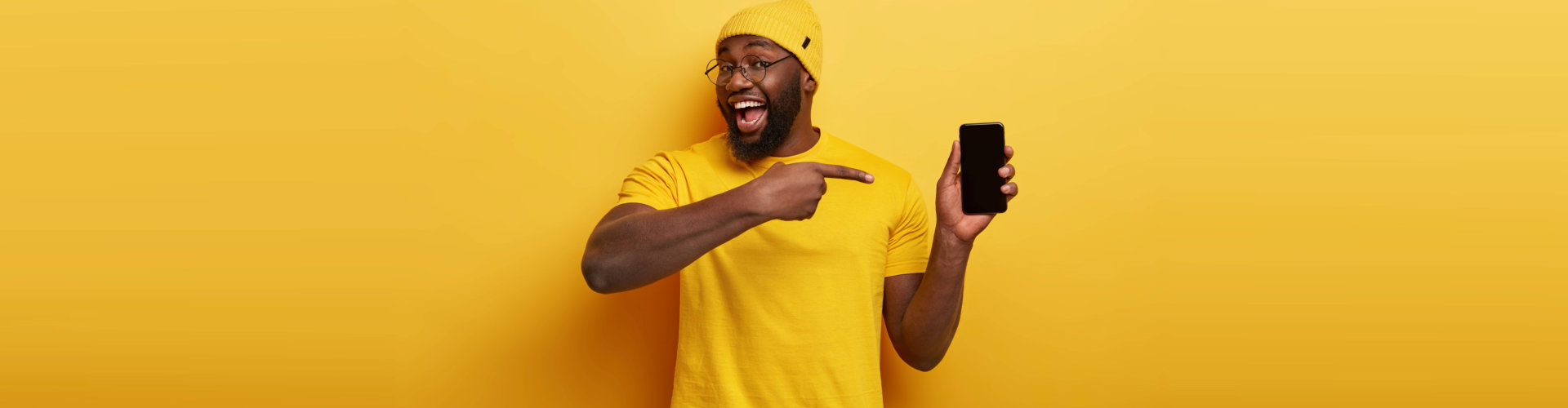 man posing for the camera with his phone